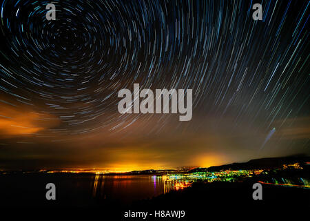 beautiful sky at night over izola with startrails - Stock Photo