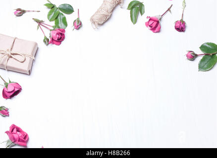 The composition, pattern of red roses, a gift on a white background. Frame of flowers. Soft focus. View from above. - Stock Photo