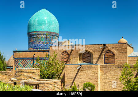 Shah-i-Zinda, a muslim necropolis in Samarkand - Uzbekistan. The ensemble includes mausoleums and other ritual buildings - Stock Photo