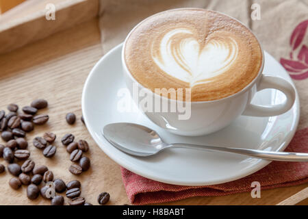 Coffee cup of Cafe' latte with heart latte art on top - Stock Photo