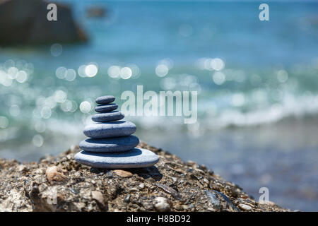 A small Zen out of a pile of stones on a rock,Stone balance - Stock Photo