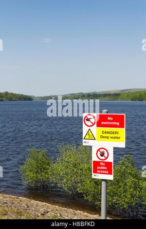 Danger deep water, no swimming sign at the south end of lower Rivington reservoir near Horwich, Lancashire. - Stock Photo