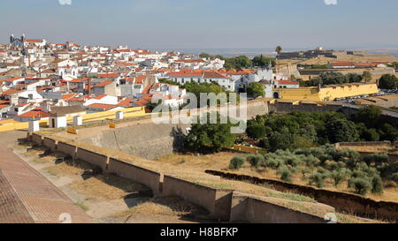 ELVAS, PORTUGAL: View of the Old Town from the city walls with Forte de Santa Luzia in the background - Stock Photo