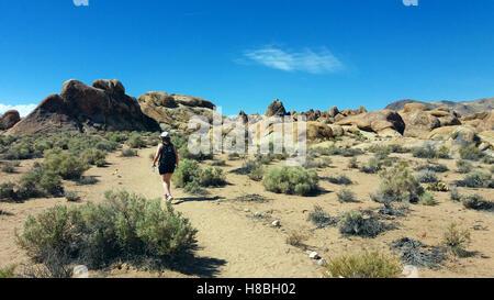 Woman hiking on Alabama Hills, California, USA - Stock Photo