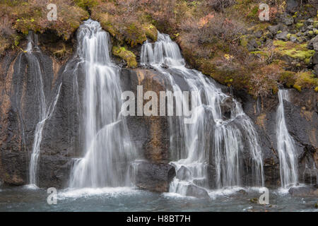 Hraunfossar is waterfall of waterfalls in near Borgarnes town Iceland - Stock Photo
