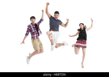 Happy young Chinese friends jumping - Stock Photo