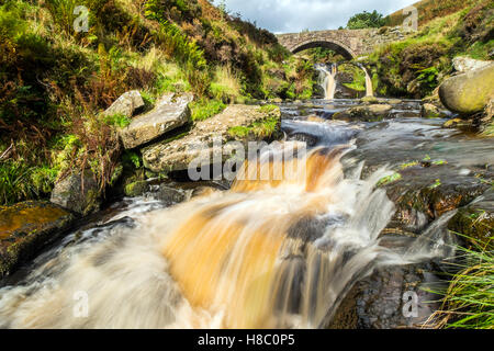 Three Shires Bridge in the Peak District, where the counties of Derbyshire, Staffordshire and Cheshire meet - Stock Photo