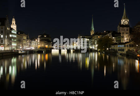 view on Fraumunster Church, Church of St. Peter and Grossmunster at night, Zurich, Switzerland - Stock Photo