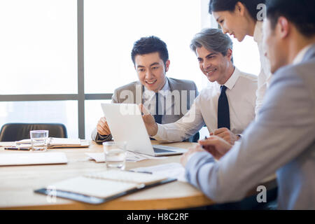Chinese business people having meeting in board room - Stock Photo