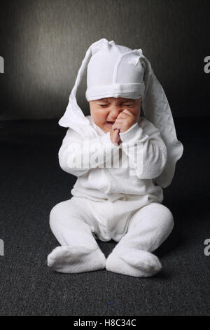unhappy boy with panty on head - Stock Photo
