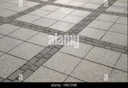 Figure out the paving slabs in the square. Background of paving slabs. Texture of stone products. - Stock Photo