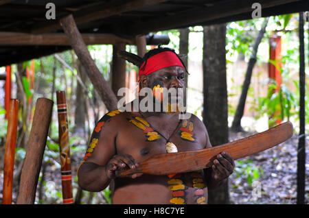 Yirrganydji Aboriginal warrior explain about Native Australian martial arts tools during cultural show in Queensland, - Stock Photo