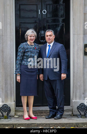 Prime Minister Theresa May meets Hungarian Prime Minister Viktor Orban.They pose for photographers on the step of - Stock Photo