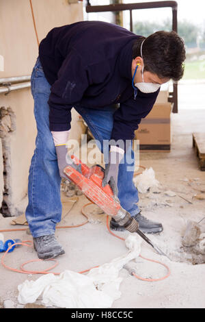bricklayer at work in a building site - Stock Photo