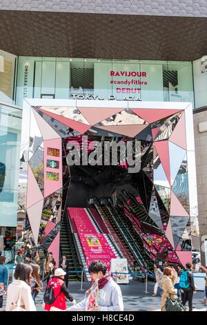 Japan, Tokyo, Harajuku. Tokyu Plaza Omotesando Harajuku, fashion theme park shopping mall entrance, steps & escalators. - Stock Photo