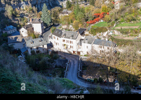 The Bozouls Hole in Autumn and a part of the village (France). That hole is a horseshoe-shaped gorge dug by the - Stock Photo