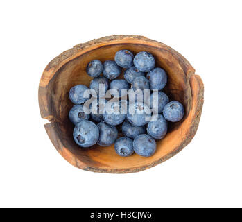 Top view of fresh blueberries in wooden bowl isolated on white - Stock Photo
