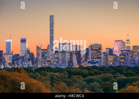 New York City skyline over Central Park in early autumn. - Stock Photo