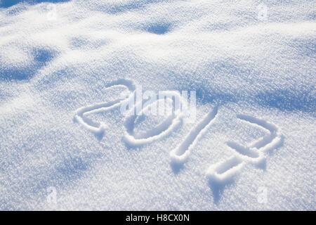 new years date 2017 written in snow - Stock Photo