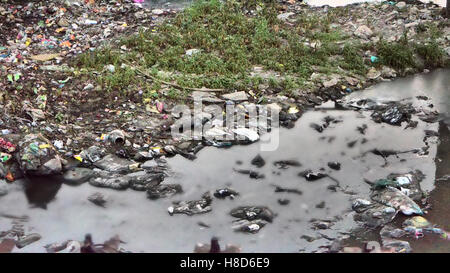 Plastic Contamination into Nature. Garbage and bottles floating on water. Environmental pollution. Garbage in the - Stock Photo