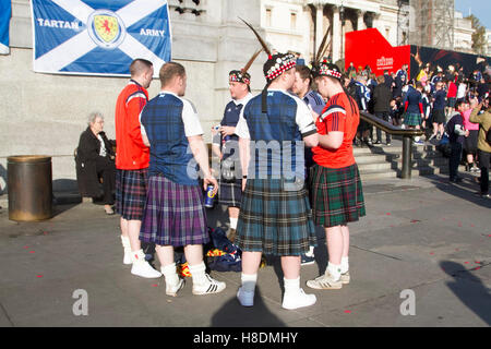 London, UK. 11th Nov, 2016. Scottish football supporters part of the Tartan army start to assemble in Trafalgar - Stock Photo
