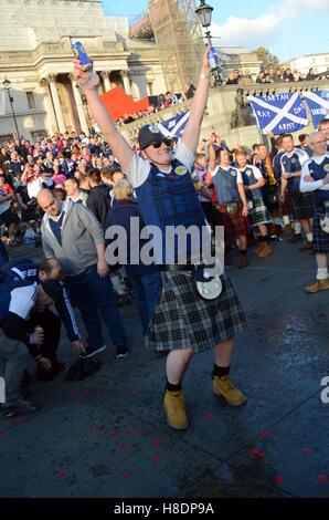 London, UK. 11th Nov, 2016. Scottish football fans gather in Trafalgar Square ahead of the the Scotland V England - Stock Photo