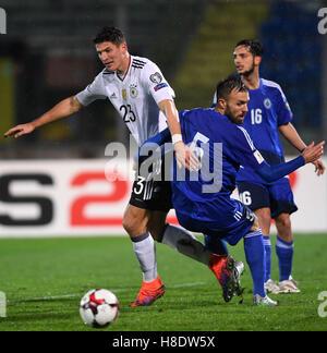 San Marino. 11th Nov, 2016. Germany's Mario Gomez (L) vies for the ball with San Marino's Matteo Vitaioli during - Stock Photo