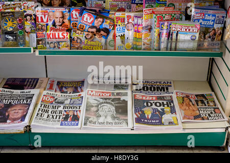 selection of uk newspapers with the headlines leading story of donald trump winning the election in usa - Stock Photo