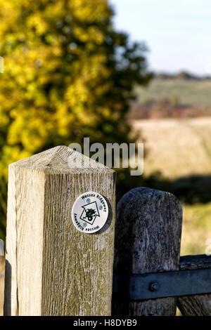 A Wessex Ridgeway Waymarker on a gate at Battlesbury Hill Fort, Warminster, Wiltshire, United Kingdom. - Stock Photo