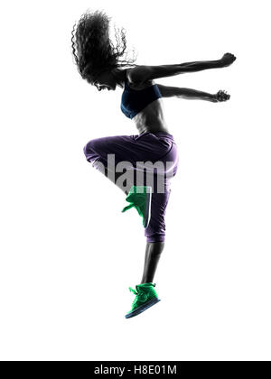 one african woman woman zumba dancer dancing exercises  in studio silhouette isolated on white background - Stock Photo