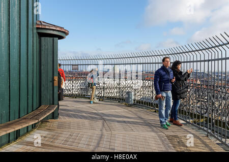 Tourists enjoying view from the Round Tower in Copenhagen, Denmark - Stock Photo