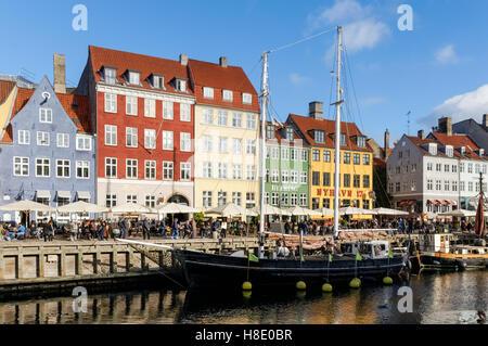 Colourful townhouses along Nyhavn canal in Copenhagen, Denmark - Stock Photo