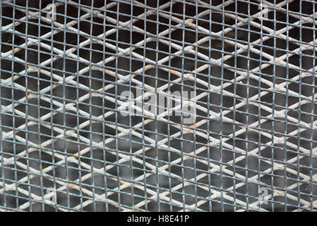 Old rusty metal grid pattern, metallic mesh, background and texture - Stock Photo