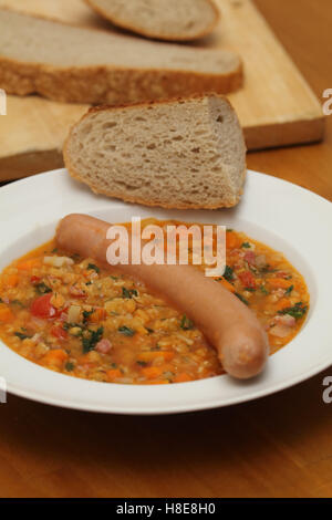 lentil stew with sausage - Stock Photo