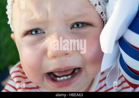 Crying girl baby - Stock Photo