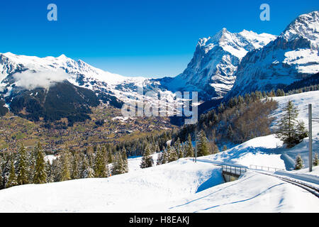 Aerial view of the Alps mountains in Switzerland. View from helicopter above glacier in Swiss Alps. - Stock Photo