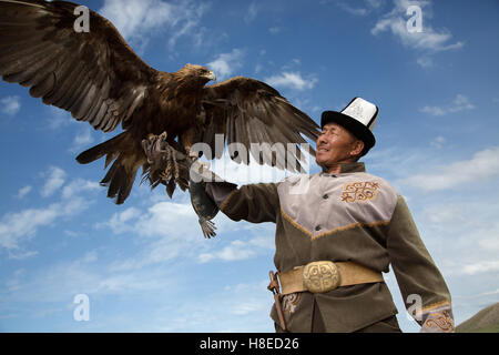 Eagle hunter in Bokonbayevo - Kyrgyzstan -  Travel people Central Asia - Stock Photo