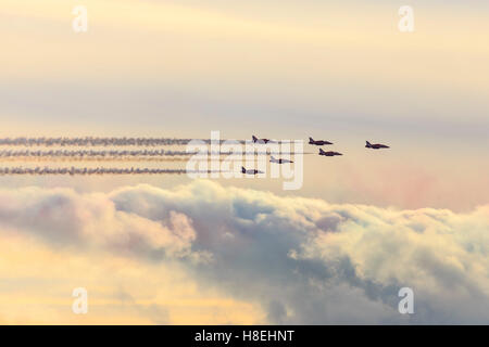Red Arrows, Royal Air Force aerobatic display team, with colourful sky, England, United Kingdom, Europe - Stock Photo