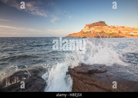 Waves of blue sea frame the village perched on promontory, Castelsardo, Gulf of Asinara, Province of Sassari, Sardinia, - Stock Photo