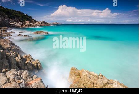 White rocks and cliffs frame the waves of turquoise sea, Santa Teresa di Gallura, Province of Sassari, Sardinia, - Stock Photo
