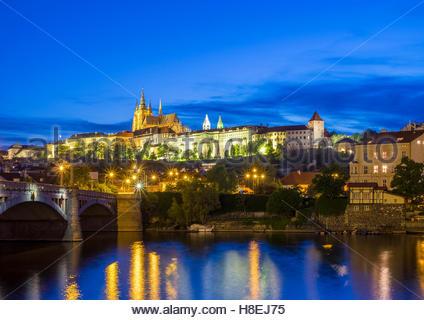 Prague Castle (Prazsky Hrad), UNESCO, on the Vltava River at dusk, Stare Mesto (Old Town), Prague, Czech Republic - Stock Photo