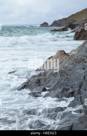 Waves on the beach at dollar cove near Gunwalloe in Cornwall - Stock Photo