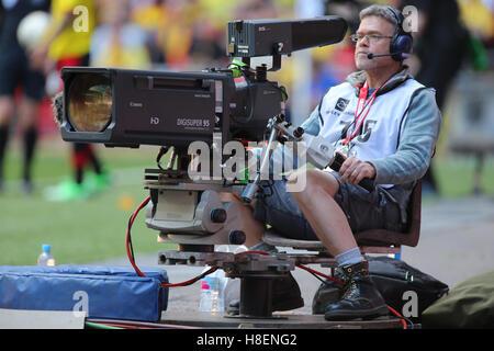 Television Cameraman at a football match. - Stock Photo
