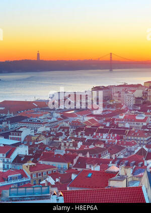 Colorful Lisbon cityscape  at sunset. Portugal - Stock Photo