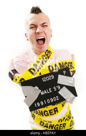 man wrapped up with danger tape - Stock Photo