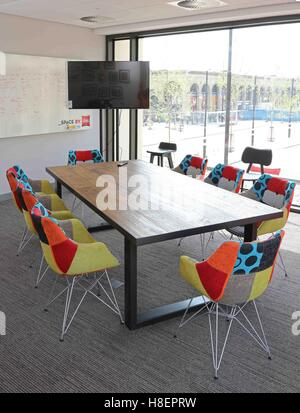 Trendy meeting room in the new Ibis Hotel in Cambridge  UK  Shows multi White chairs and table in white loft conversion kitchen dining  . Meeting Room Table And Chairs Uk. Home Design Ideas