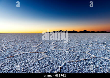 Sunrise at the Salar de Uyuni in Bolivia, South America; Concept for travel in Bolivia and South America - Stock Photo