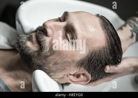 Washing head in barbershop - Stock Photo