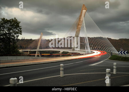 Light trails on Pont de Terenez, Finistere, France - Stock Photo