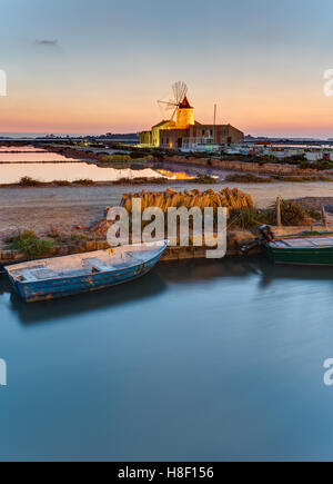 Dawn at the saltpans of Marsala in Sicily, Italy - Stock Photo